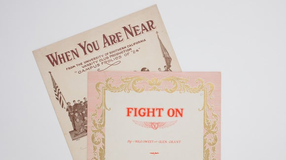 "Examples from the University Archives, including a ""Fight On"" songbook."