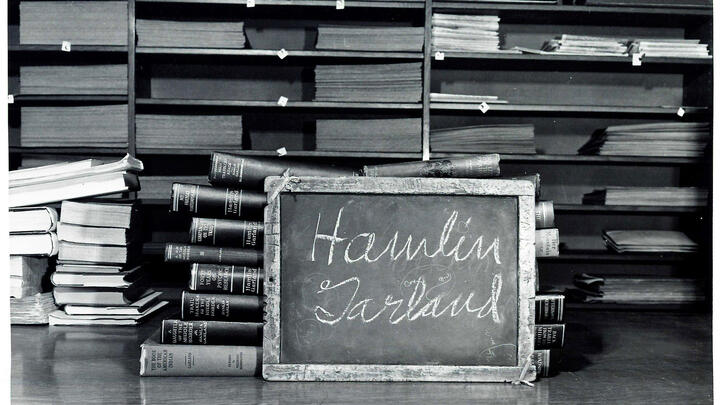 Hamlin Garland's name written on a school slate carved with his initials.